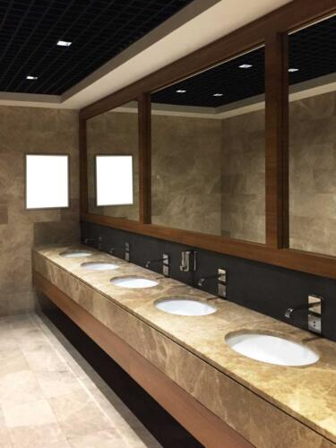 Public restroom with information or advertisement board (board has clipping path)